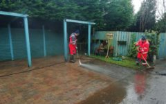 PJ and Pat clean the tiled area